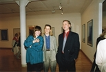 Photograph: John MacKechnie with Morag Davidson and Petra Firsching at the opening of the exhibition 'John Taylor - New Work' (1991)