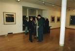 Photograph: A small group  of people talking at the exhibition 'John Taylor - New Work' (1991)