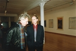 Photograph: John MacKechnie talking to Douglas Thomson at the opening of the exhibition 'John Taylor - New Work' (1991)
