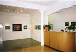 Photograph: The front desk of the Glasgow Print Studio Gallery during the exhibition 'Neil MacPherson - Paintings' (1998)