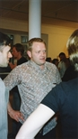 Photograph: Ray Richardson at the opening to his exhibition 'Paintings and Prints' (1998)