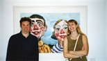 Photograph: Two people posing in front of one of a print at the opening of the exhibition 'Mark Hampson - Prints' (1998)