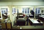 Photograph: 2 unknown people working in Glasgow Print Studio workshop (around 1990)
