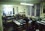 Photograph: Stuart Duffin in the screenprinting area of the Glasgow Print Studio workshop (around 1990)