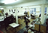 Photograph: Eveleen Wright working at the etching area in Glasgow Print Studio workshop (around 1990)