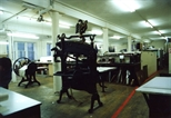 Photograph: The Eagle Relief press and etching area in Glasgow Print Studio workshop (around 1990)