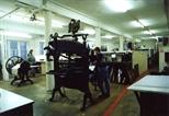 Photograph: Several people working in Glasgow Print Studio workshop (around 1990)