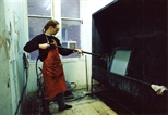 Photograph: Stuart Duffin in the screen washout area in Glasgow Print Studio workshop (around 1990)
