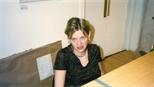 Photograph: Carolyn Nicholl sitting behind the Glasgow Print Studio Gallery desk (2001)