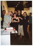 Photograph: Various people posing for a photograph at opening of 'Alive and Printing' in Kelvingrove Art Gallery and Museum (2002)
