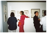 Photograph: Various people viewing the works at opening of 'Alive and Printing' in Kelvingrove Art Gallery and Museum (2002)