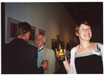 Photograph: Hetty Haxworth holding a bottle of wine at the opening of 'Alive and Printing' in Kelvingrove Art Gallery and Museum (2002)