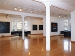 Photograph: A wide shot of Glasgow Print Studio Gallery during the exhibition 'James McDonald - Reflections' (2002)