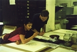 Photograph: Norman Mathieson and an unknown girl painting in the Glasgow Print Studio workshop (2002)