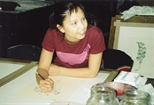 Photograph: A young woman colouring a print in Glasgow Print Studio workshop (2002)
