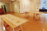 Photograph: 2 tables of etchings by Christine Borland from her joint exhibition 'Dragon Doll' with Claire Barclay (2002)