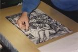 Photograph: Adrian Wiszniewski working on a lithographic stone