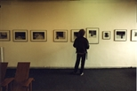 Photograph: John Taylor looking at the Ursula Jakob exhibition